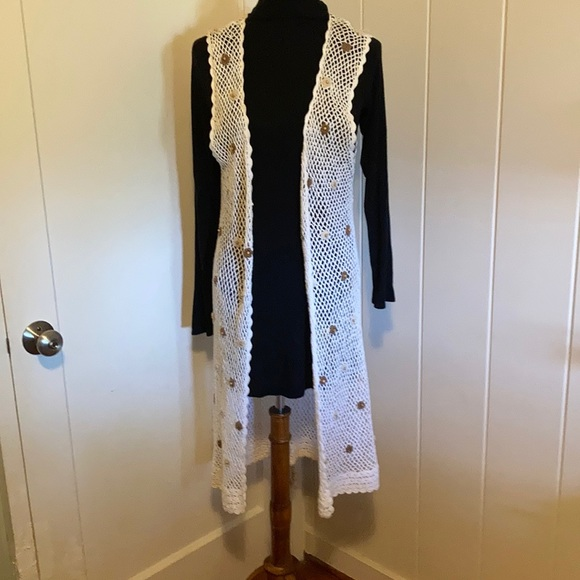 Crochet cream cover up with earth tone flowers